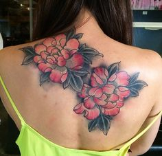 Tattoo artist @larascotton designed these big, beautiful flowers to cover up another tattoo. We love the huge blooms.