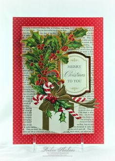 I used the Anna Griffin Holiday Trimmings cardmakinig kit to create this card.