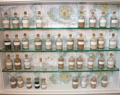 I wish I had started this 10 years ago.BEACH SAND COLLECTION A display case contains bottles of sand collected from beaches all over the world for the past 30 years. Woodlawn Blue, Glass Bottles With Corks, Bottles And Jars, Small Bottles, Coastal Homes, Coastal Decor, Home Beach, Beach House, Beach Art