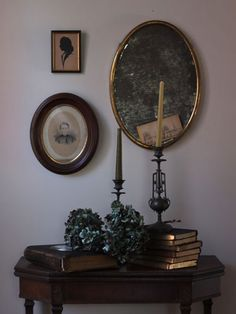 Design Skool blogger Justine Hand used her collection of vintage books and candlesticks to turn a basic entryway table into a gothic-themed display.
