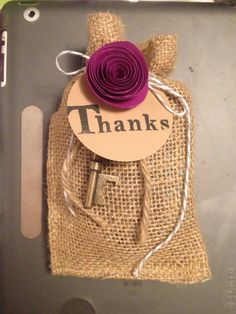"The ""Thank You"" treats for the table settings  Filled with cookies and the antique key is a bottle opener."