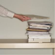 Decluttering Stacks of Paper- Best How To Organizing website I've seen.  Explains reasons behind clutter buildup and how to fix it.