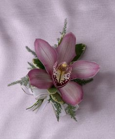 A beautiful orchid corsage is perfect for Mom on her special day or to help dress up an Easter outfit.    Flowers featured: pink cymbidium orchid.