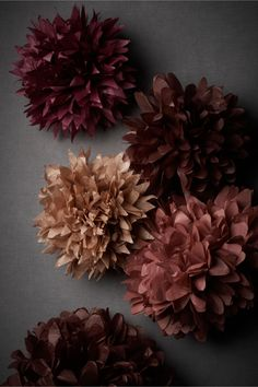 paper flowers as wall decorations-- perhaps hang them on the wall with command clips?