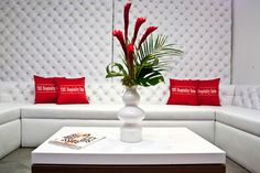 """""""The Hospitality Suite"""" for the Golden Globes. Events By Fabulous used red accents in the all-white lounge space at Confidential Beverly Hills. Tropical flowers in modern vases, available... Photo: Erik Voake"""