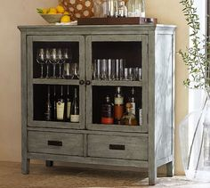 Amelia Glass Cabinet | Pottery Barn--for under tv. will use for linen storage or baskets with other stuff