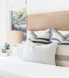 Dream bedroom idea withcane headboard and a soft cali design vibe. How to arrange pillows on a bed. How to make a guest bedroom feel welcoming. Bedroom Decor ideas on a budget Home Decor Bedroom, Bedroom Decor, Bedroom Interior, Home, Cheap Home Decor, Bedroom Inspirations, Home Bedroom, Home Decor, Coastal Bedrooms