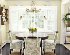 "Dining Room Chair Slipcovers with top of wood showing. Home of Terri Perry, slipcovers sewn and designed by Caroline Hopewell. She ""devised the tie-on cover for the seat, leaving the rest of the upholstery whitef."" featured in Country Living"