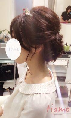 ルーズシニヨンとナチュラル編み込みスタイル♡リハ編 |大人可愛いブライダルヘアメイク『tiamo』の結婚カタログ