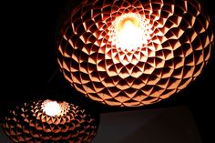 """Edward Linacre design lights - The Nest """"A pendant lighting fixture that pays homage to the honeycomb architecture of a bee's nest""""."""