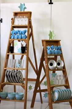 Ladders used a display shelves. Idea for a craft fair booth