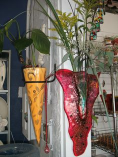 A glass wall vase and a pottery wall vase. Both look so fabulous!