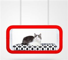 The Suite pet lounge is shaped in two colors and finished in gloss lacquer with a soft cushion kept in place by magnets.  Suite can either be placed on the floor or suspended: with metal feet or cables in steel.  This innovative design is conceived for small pets. Find it at www.modpetlife.com