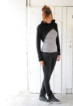 https://www.cityblis.com/1329/item/13246  Black long sleeve shrug - $63 by dressign  Black jersey shrug with long sleeves  A simple and unique bolero inspired from architecture. Its asymmetrical pattern on the front and its loose fit back make your waistpart look thinner and also add a feminine touch. The combination of strong colors with its geometrical cut allows you to distingui...