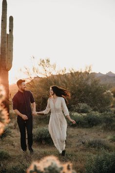 Eloping couple run amongst saguaro cacti at Lost Dutchman State Park in the Superstition Mountains outside Phoenix, Arizona. Superstition Mountain Arizona elopement photographer Unique Engagement Photos, Engagement Photo Poses, Engagement Photography, Photography Poses, Wedding Photography, Anniversary Photography, Anniversary Photos, Bohemian Wedding Inspiration, Engagement Inspiration