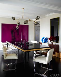 A purple wall in a dining room, who'd have thought?! It's unexpected.