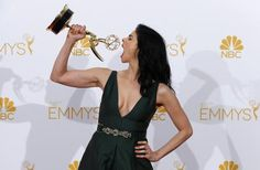 """Sarah Silverman poses with her Outstanding Writing for a Variety Special award for HBO""""s """"Sarah Silverman: We Are Miracles"""" at the 66th Primetime Emmy Awards in Los Angeles, August 25, 2014."""