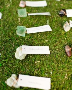 Small stones were wrapped in copper wire and affixed to escort tags for this outdoor real wedding