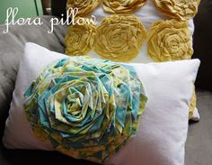 Tutorial and video on how to make these flowers and pillows. Too cute.