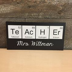 One of my sweetest friends went back to teaching high school science this year after being home with her babies for so long. I just had to create a fun sign for her new classroom. Wooden Sign measures approx. 5 1/4x11 and states: TeAcHEr Teachers Name Please let us know in the