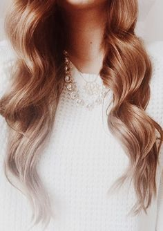 Loose curls, I achieve this look with a wand, but know I would have looser flowing waves with a marcel curling iron