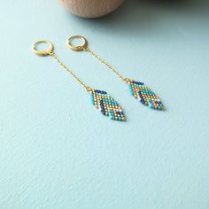 Here are original beaded earrings (brick stitch) made with gold plated materials (24 carats thin gold plated) and japanese glass beads = Miyuki delicas. Earrings that will make you beautiful unic and special. Unique and handmade jewelry. Chain may vary according to the stock.