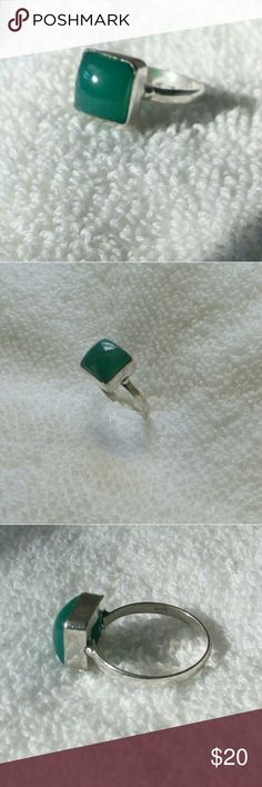 Blue/Green Onyx Ring Wearing  Onyx is said to be a strength giving stone providing support in difficult or confusing times! This beautiful ring is 8mm square on a simple shank. The height runs approx 7 mm. Very smooth. The green looks darker inside than in the sun and is a blue green. The base metal is bronze with a 925 Sterling Silver Overlay. Pic 6 shows the darker green color. It doesn't fit any finger so that is why I'm selling. Boo! Jewelry Rings