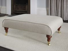 The sofa.com Ottoman is classic in Undyed broad weave linen - $340