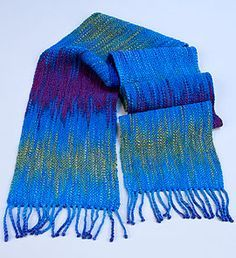 Painted-Skein Warps   Syne Mitchell - Great article on 1) how to recognize a skein of yarn that is suitable for this type of scarf (a palindrome skein), 2) how to warp a rigid heddle loom to make best use of the color in the skein, and s3)uggests a con-air hairbraider for twisting fringe.