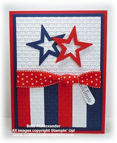 Homemade 4th of July card ... red, white and blue ... die cut star frames ... stripes ... lik the use of wide ribbon with a knot to separate top and bottom panels ... great card!