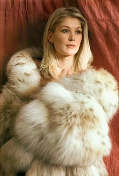 Anyone know if this is Rosamund Pike (Bond Girl from Die Another Day)? Anyway she looks incredible in that coat she is wearing!