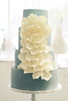 Blue wedding cake with large white flower