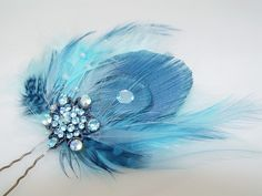 Baby Blue Feather and Rhinestone Fascinator Comb Bridal Wedding Hair Piece. $48.00, via Etsy.