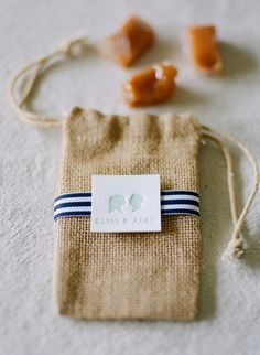 small berlap bag of caramel favors - photo by  Josh Gruetzmacher