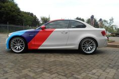 image of BMW 1M Matte White Motorsport Stripes Wrap 750x500