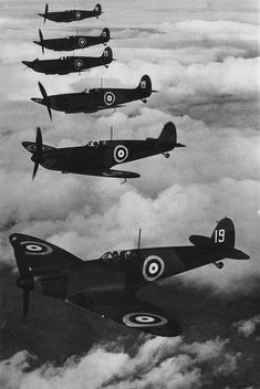 Fighter squadron of spitfires in formation    Description: Photograph from the log book of RAF Squadron Leader B.J.E. Lane.    Date: 1942