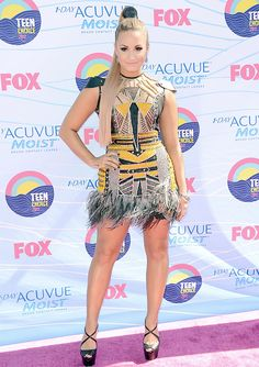 Was Demi Lovato's tribal feathery look a hit or miss at Teen Choice Awards?