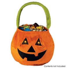 "Light-Up Pumpkin Bag - A fright night must-have. 7 1/2"" H x 9 1/2"" W bag with bright LED lights for eyes. Uses 3 AAA batteries (not included). Ages 6 and up. Polyester with vinyl lining. Spot clean. item#096-975  $3.49 while supplies last!  http://youravon.com/irmae"