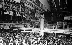 Jam-packed view of Studio 54. A shot of the dance floor, DJ booth, and balcony in 1975 -- http://kittensandaprons.blogspot.com/2013/04/studio-54.html
