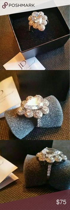 Jean Dousset Absolute Collection Ring Size 7 Beautiful Jean Dousset Absolute Collection Ring NEW! 3 Carat CZ Center Stone surrounded by 8 1/2 Carat CZ Round Stones. The ring is Sterling Silver. The ring is a Size 7. Jean Dousset  Jewelry Rings