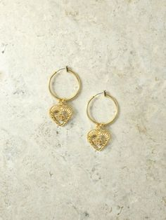f170592d0 The Adorar Heart Charm Earrings are 24K Gold Plated Hoops with Etched  Triple Heart