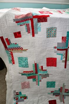 Red and aqua Converging Corners quilt with link to tutorial