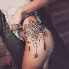 mandala style tattoo on thigh/hip
