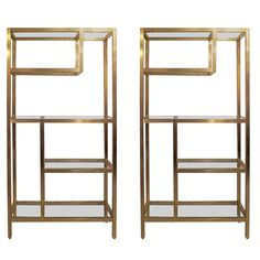 Pair of Modern Brass Etageres or Bookcases | From a unique collection of antique and modern bookcases at https://www.1stdibs.com/furniture/storage-case-pieces/bookcases/