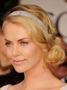 The bun is a hairstyle that's the perfect blend of elegant and cool. (Just look at Charlize Theron, above—talk about hair inspiration.) It's all in the details (hint: a mussed finish and the right placement are key). Here, three ways to upgrade the classic updo. | allure.com