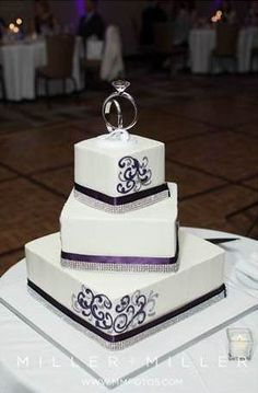 Purple/Plum wedding cake with diamonds.  Engagement ring cake topper.