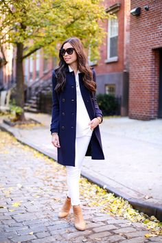 Kat Tanita of With Love From Kat wears a navy blue Tory Burch coat with white skinny jeans and tan Rag & Bone booties in the West Village, NYC during fall.