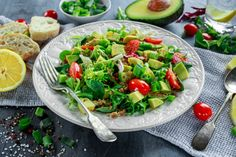 quinoa tabbouleh salad with avocado tomatoes cucumber green onion