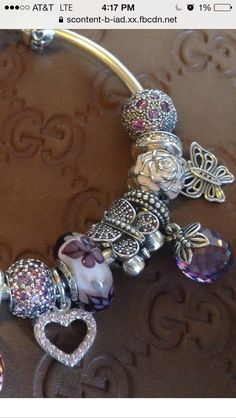 Pandora cosmic clips. Loving the butterfly and lavender globe charms!