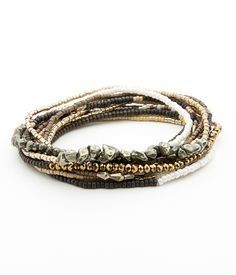 Refined gold and silver bracelet adorned with pyrite nuggets and gold semi-precious gemstones - See more at: www.kharijewelry.com